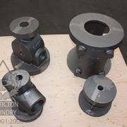 Oil pump parts cast in ductile iron including BOP, wellhead frame and stuffing box.