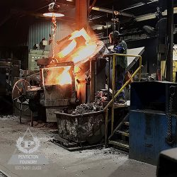 A worker pours ductile iron, ASTM A536