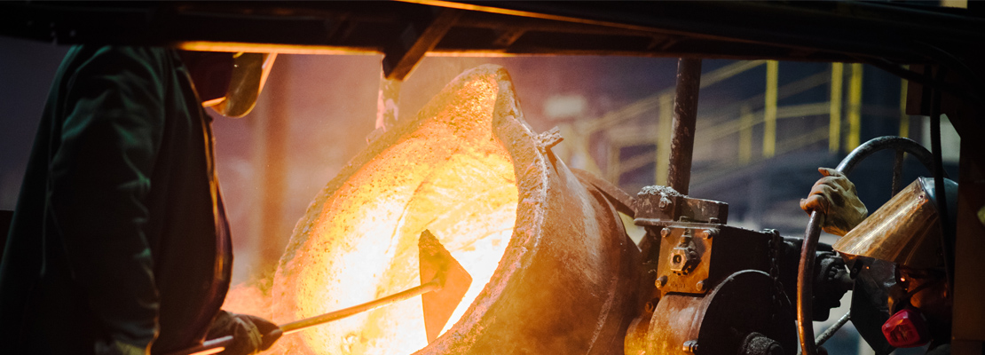 A foundry worker pours chrome white iron, one of many iron alloys