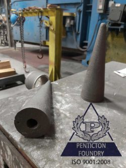 A48 Class 20 gray iron flow control plugs used in the aluminum smelting industry.