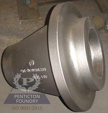 An automotive bearing housing made from ASTM A 48 Class 40 gray iron.